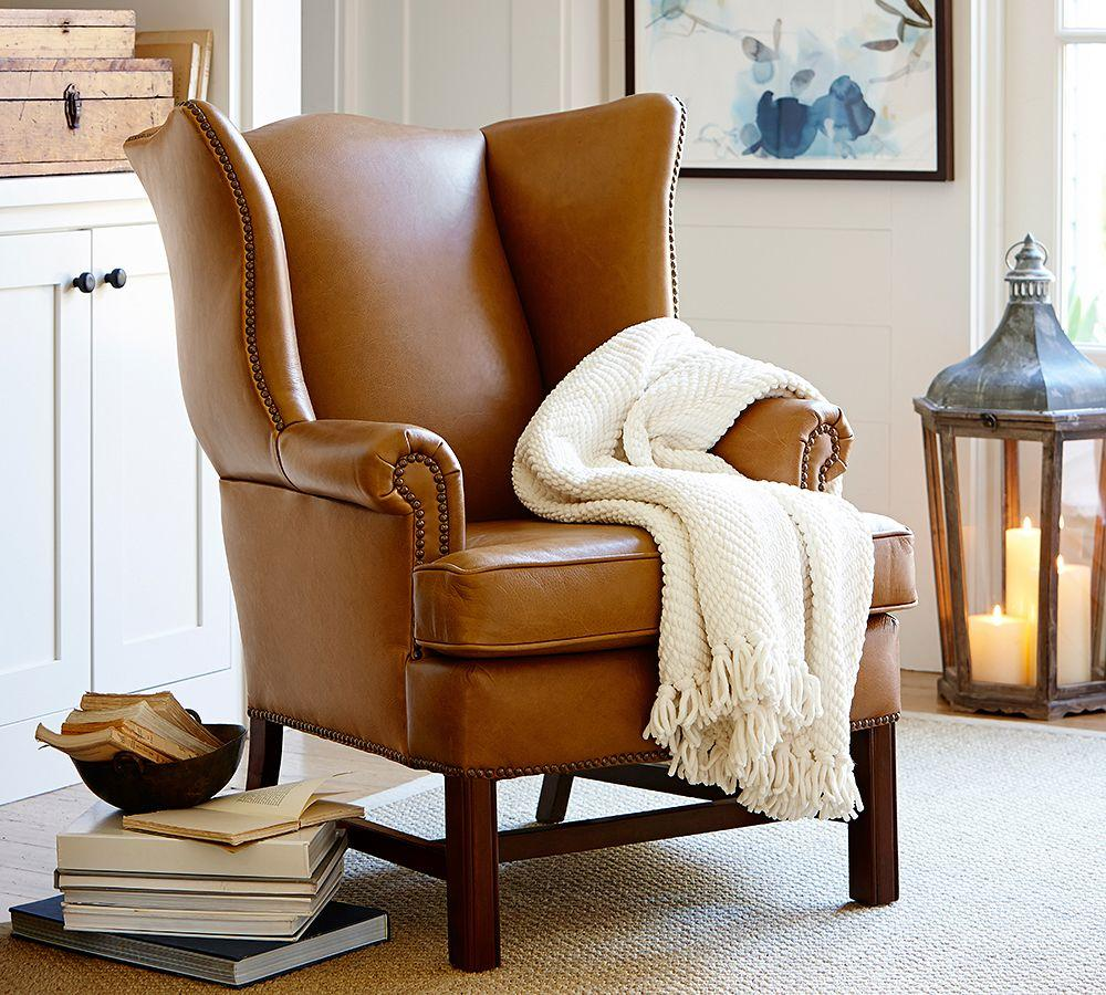Thatcher leather wingback chair pottery barn for Sitting furniture living room
